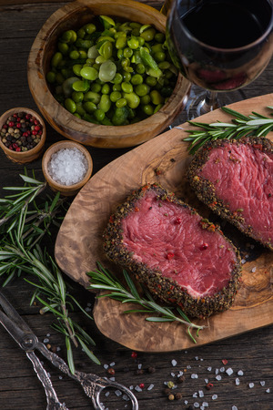 Beef steak fillet with pepper on rustic table