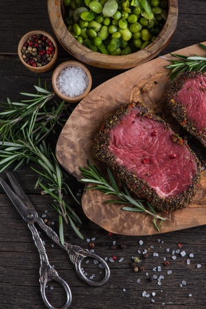 red meat: Top view on raw steak with herbs and pepper