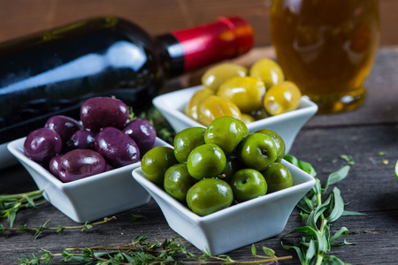 Selection of fresh olives with herbs