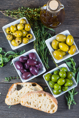 black bread: Selection of fresh olives with herbs and oil from above Stock Photo
