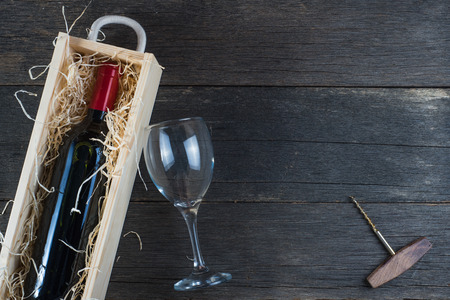 wood box: Wooden wine case with red wine on rustic background
