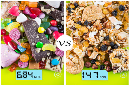 versus: Sweet and junk food contra healthy snacks concept Stock Photo