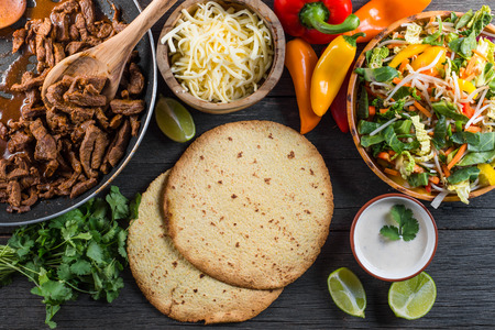 taco: overhead view on authentic mexican street taco with beef and vegetables Stock Photo