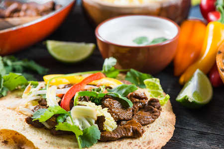 food ingredient: close view on mexina tacos with beef and vegetables