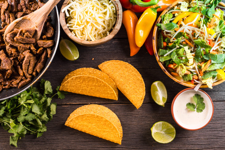 rustic food: overhead view on authentic mexican street taco with beef and vegetables Stock Photo