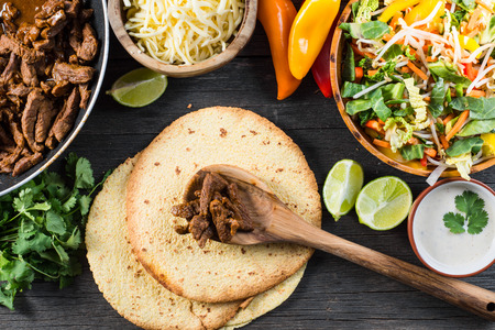 rustic food: preparation authentic mexican tacos, top view