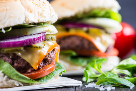classic burger: traditional pub style burger  on wooden table Stock Photo