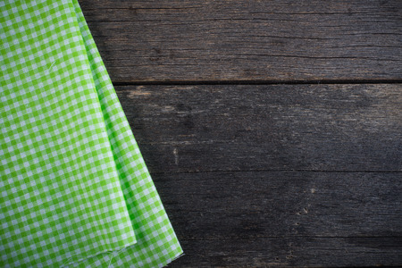 Kitchen cloth on rustic wood background template 免版税图像