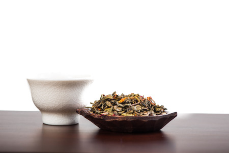 antioxidant: Aromatic antioxidant green tea on wooden board, isolated background