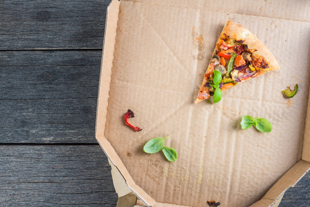 pizza crust: leftovers slices of homemade vegetarian pizza in box from above