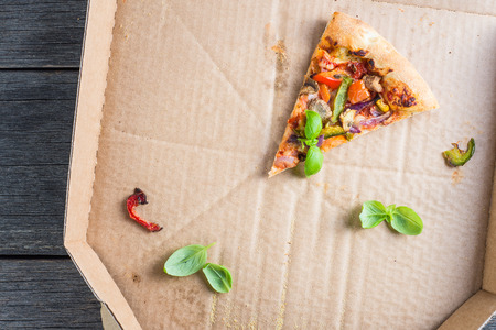 leftovers: leftovers slices of homemade vegetarian pizza in box from above