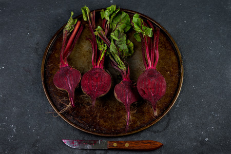 roasting: Farm fresh beetroots cut in half for roasting, from above Stock Photo