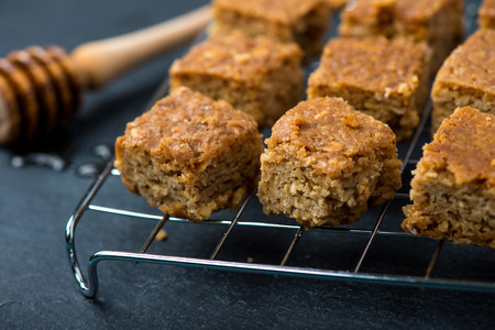 flapjacks: Homemade healthy flapjacks with honey on cooling rack