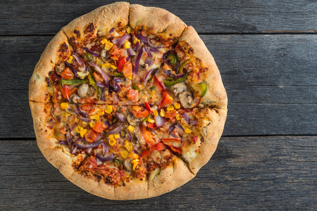 vegeterian: Homemade vegeterian pizza from above on wooden rustic table Stock Photo