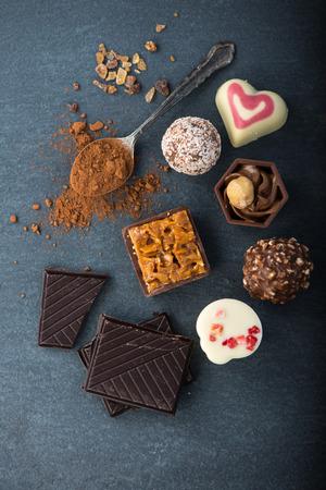 praline: selection of artisan chocolates praline on black background Stock Photo
