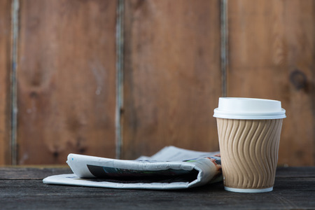 blank newspaper: Take away coffee and newspaper on wooden background Stock Photo
