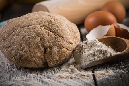 artisan bakery: Wholegrain dough for homemade bread, prepared on wooden table