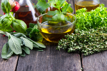 Fresh herbs from garden with olive oil, seasoning background