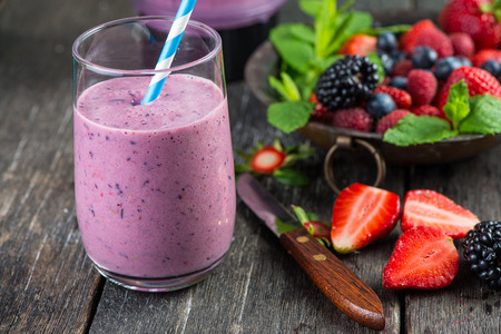 of fruit: Homemade antioxidant summer fruits smoothie on rustic table