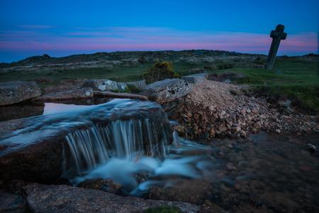 granite park: Legendary Druid granite cross in Devon Park at twilight, with time lapse stream