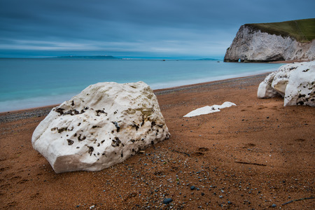 jurassic: Beach in Jurassic Coast in Dorset, UK at twilight with long exposure motion blur Stock Photo