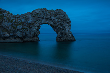 durdle door: Durdle Door arch in Jurassic Coast in Dorset, UK at twilight