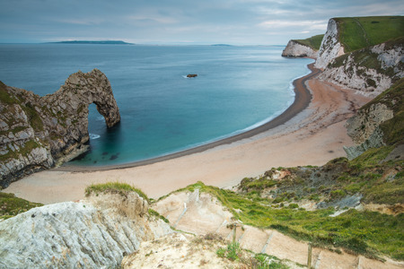 Durdle Door arch in Jurassic Coast in Dorset, UK at twilight