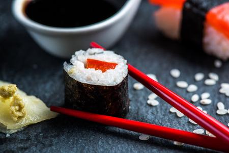 SUSHI: Sushi, chopsticks and wasabi on black slate