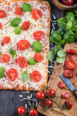 margherita: Making Homemade classic margherita pizza from above