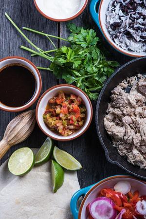 rustic food: Preparation of classic street food burritos on rustic table Stock Photo
