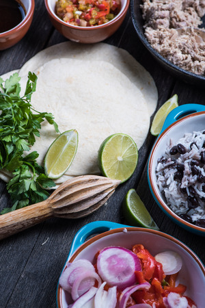 burrito: Making traditional mexican burritos with pulled beef, from above Stock Photo