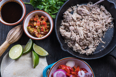 burrito: Preparation of classic street food burritos on rustic table Stock Photo