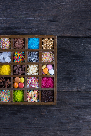 vibrat: Vintage box with vibrat sugar decorations from above