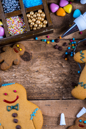 gingerbread cookies: Homemade gingerbread cookies, decorating for Christmas on wooden table