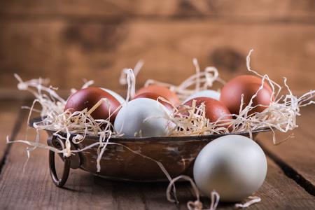 free range: Farm fresh free range eggs in rustic bowl, on wooden table