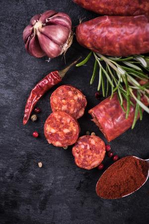 chorizo: spanish chorizo with herbs, food background
