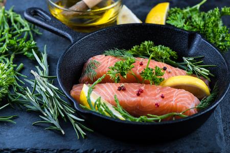 steak plate: salmon steaks with herbs on rustic pan, diet concept