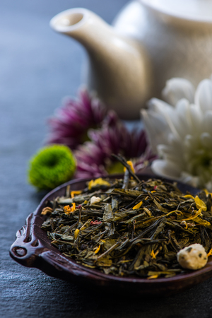 antioxidant: Aromatic tea with flowers and fruits, antioxidant and diet concept Stock Photo