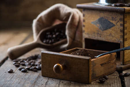 grinded: Fresh grinded coffee beans on wooden background