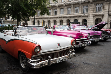 habana: Havana, Cuba - September 22, 2015: Classic american car parked on street of Old Havana,Cuba. Classic American cars are typical landmark and atraction for whole Cuban island.