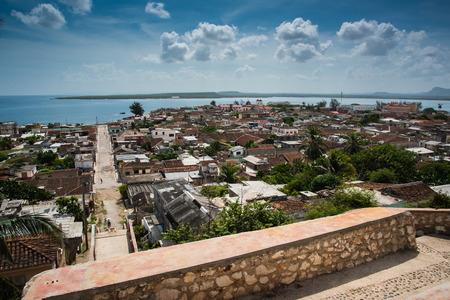 habana: Cuba traditional colonial village of Gibara in Holguin province, hill top view Stock Photo