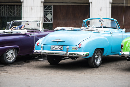 atraction: Havana, Cuba - September 22, 2015: Classic american car parked on street of Old Havana,Cuba. Classic American cars are typical landmark and atraction for whole Cuban island.