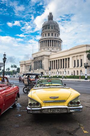 capitolio: Havana, Cuba - September 22, 2015:  Classic american car and Capitolio landmark in Havana,Cuba. Havana is tourist most popular destination in whole Cuba island.