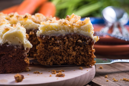 Homemade autumn carrot cake on wooden table