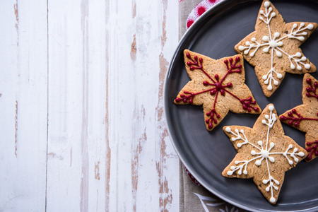 Christmas cookies on wooden background, overhead view