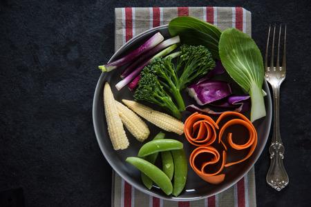 fruit plate: Fresh vibrant vegetables background Stock Photo