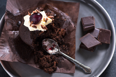 dark: Chocolate muffin on dark background Stock Photo