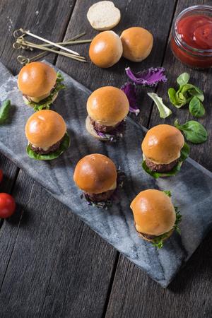 steak sandwich: mini beef burgers,party food on wooden table