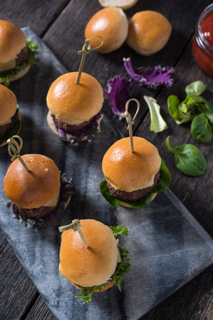 mini: mini beef burgers,party food on wooden table
