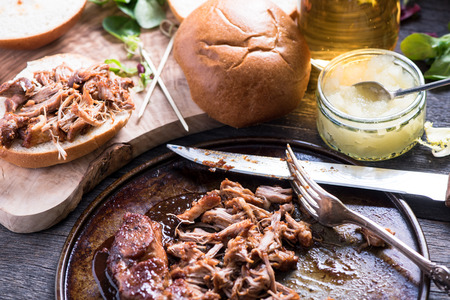 bap: roasted pulled pork bap served with cider and apple chutney Stock Photo